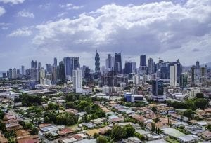 Panama City, Panama. Skyscrapers with sea and cloudy sky in the background.